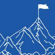 outline of mountains with flag staked at the top over a dark blue background